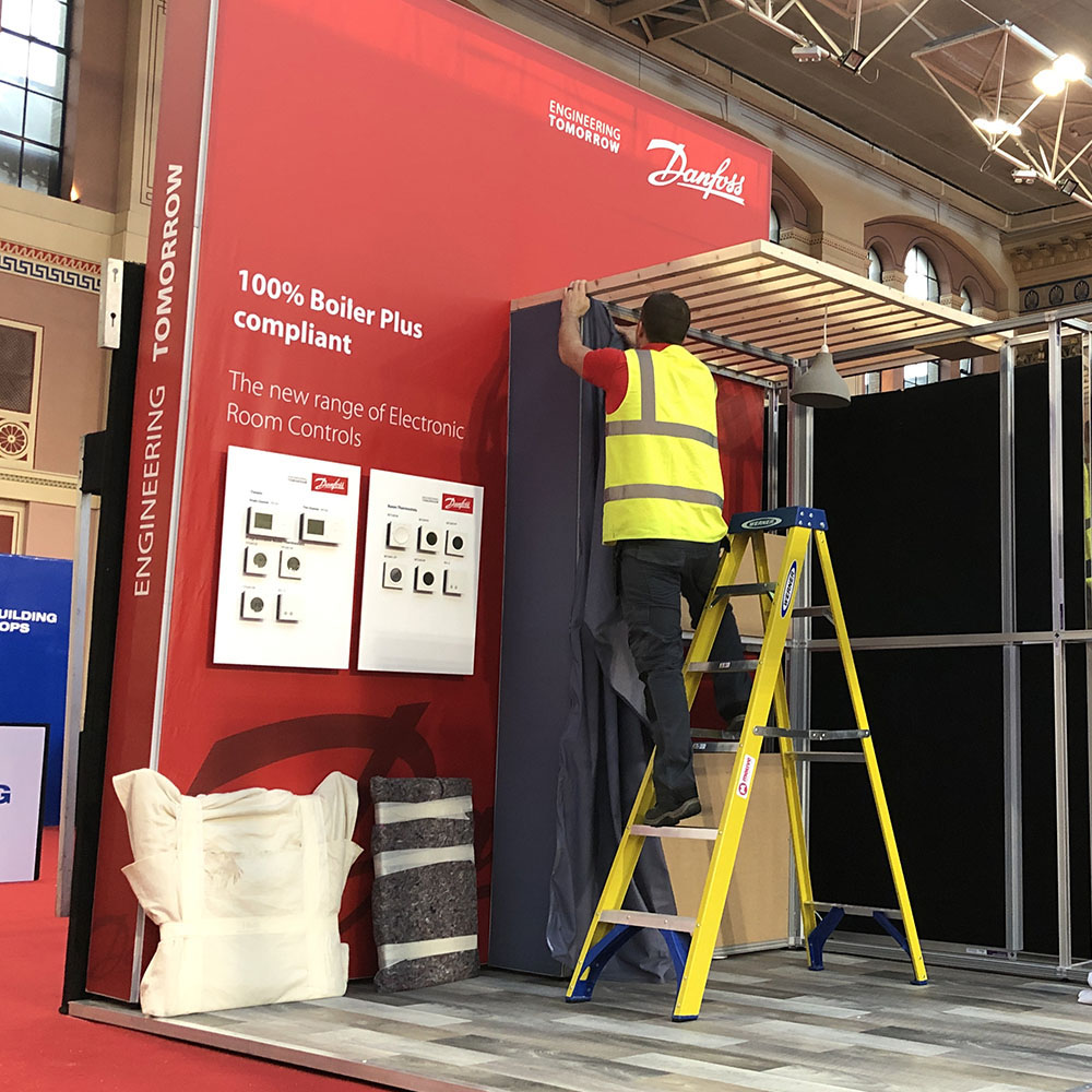 Exhibition Fitter on Ladder